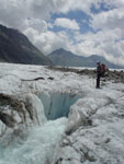 A river by melting ice disappears in this huge hole in the ice, Aletsch Glacier, Swiss